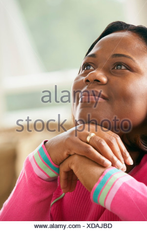 Woman Looking Up In Contemplation - Stock Photo
