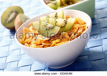 Cornflakes with kiwi slices - Stock Photo