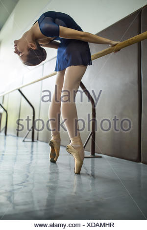 Young dancers doing a workout in the classroom near barre. Stret - Stock Photo