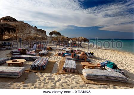 People at beach on pillow seats, beach, parasols, lagoon, swimmers, people, Beach Mahmya, beach, Giftun Island, Hurghada, Egypt - Stock Photo