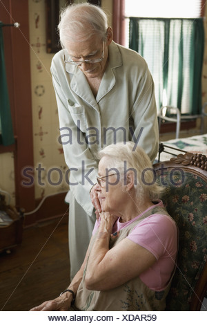 Elderly couple comforting each other - Stock Photo
