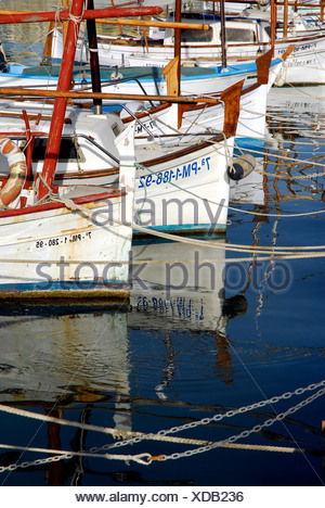 White fishing boats and sailing boats in the port at the Passeig Maritim, Port de Palma, Palma de Mallorca, Majorca, Balearic I - Stock Photo
