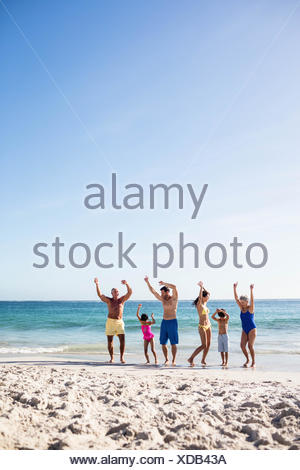 Cute family with arms outstretched - Stock Photo