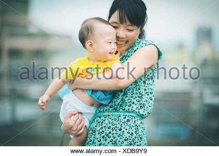 Mother holding son while dancing - Stock Photo