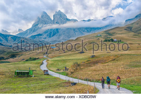 Hikers in front of the Aiguille d'Arves, Ecrins, Savoie, France - Stock Photo