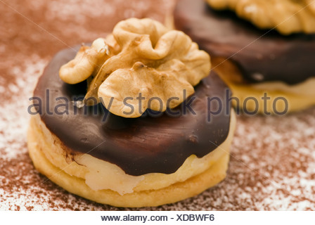 Christmas cookies with nougat, marzipan and walnut as closeup on powdered white background - Stock Photo