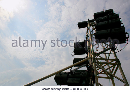 Lighting equipment against cloudy sky - Stock Photo