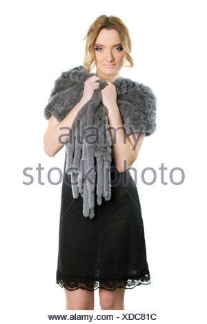 woman in a black cocktail dress - Stock Photo