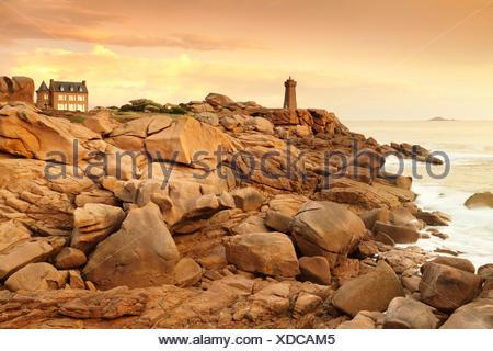 Phare de Ploumanac'h or Phare de Mean Ruz lighthouse on the Côte de Granit Rose or Pink Granite Coast, Ploumanac'h, Brittany - Stock Photo