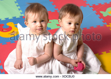 Baby twins, 10 months - Stock Photo
