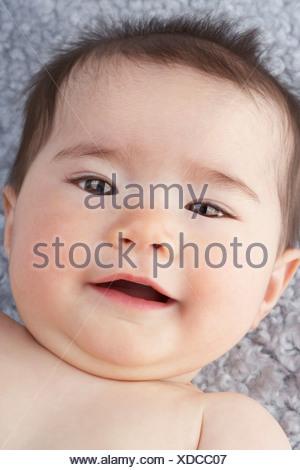 A baby girl lying down - Stock Photo