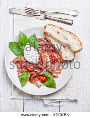 Ham salad with poached egg - Stock Photo
