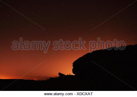 Scenic View Of Silhouette Rock Against Star Field At Night - Stock Photo