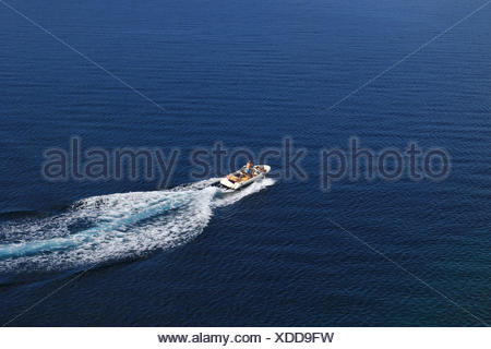 Speed boat aerial view on blue sea - Stock Photo