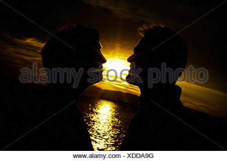 Two men and a beautiful sunset - Stock Photo