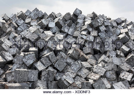 Mountain of scrap metal, pressed into cubes, metal waste from industrial production, Port of Duisburg, Duisport, Ruhr district - Stock Photo