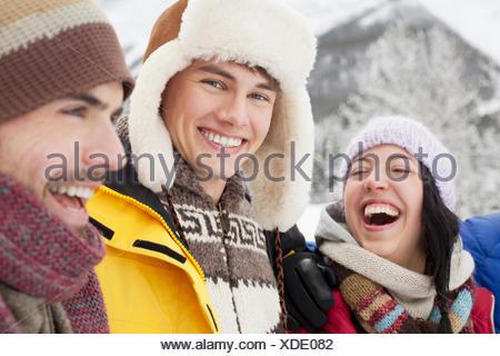 friends enjoying the snowy outdoors - Stock Photo