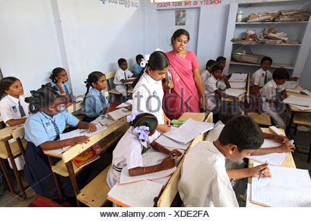 Vijayawada, India, a school class in the classroom with the teacher - Stock Photo