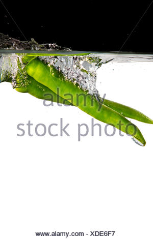 green hot peppers in water - Stock Photo