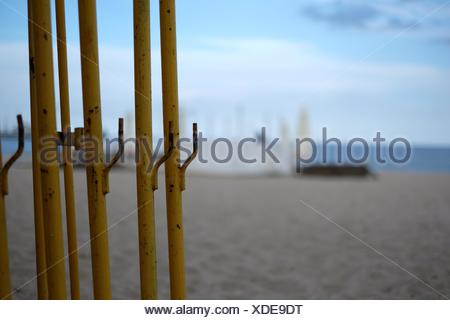 Close-Up Of Metal Bars At Beach Against Sky - Stock Photo