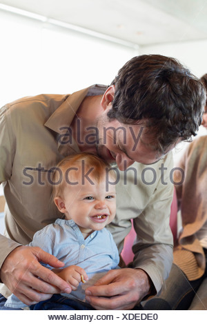 Close-up of a man with his son smiling - Stock Photo