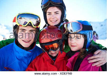 Sisters and brothers on skiing holiday - Stock Photo
