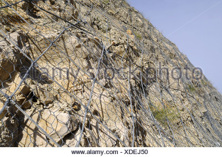 Mounting against rockfall - Stock Photo