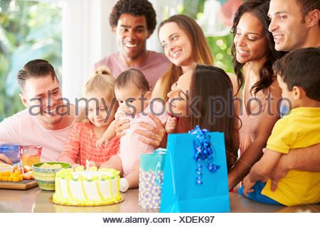 Group Of Families Celebrating Child's First Birthday At Home - Stock Photo