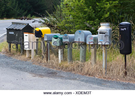 Row of different mailboxes on the roadside, Seacliff, Otago Region, New Zealand - Stock Photo