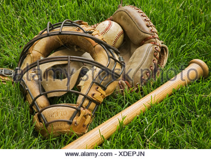 Old fashioned baseball equipment in grass