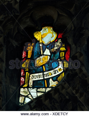 Wiggenhall St. Mary Magdalene, Norfolk, St. Cuthbert, Bishop of Hexham, d. 687 English medieval stained glass window windows - Stock Photo