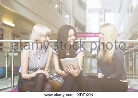 Young women using digital tablet - Stock Photo