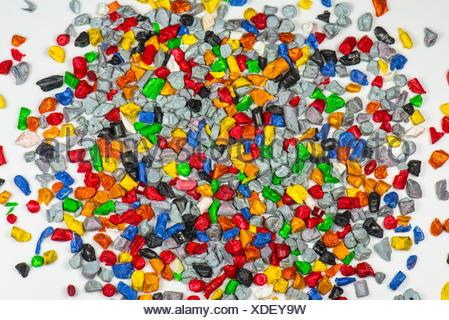 regrind of multi colored plastic parts - Stock Photo