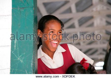 Schoolgirl in uniform during break, Amerindians, tribe of the Arawak, Santa Mission, Guyana, South America - Stock Photo