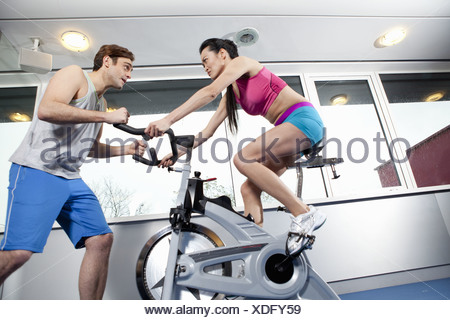Woman working with trainer in gym - Stock Photo