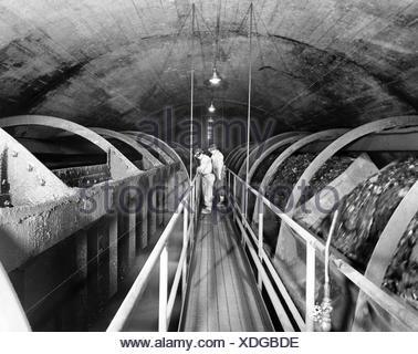 USA, Pennsylvania, Robena Mine, Two workers standing in coal mine - Stock Photo