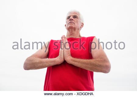 Senior man in lotus position - Stock Photo