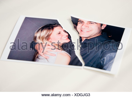 Photograph of couple ripped in half - Stock Photo