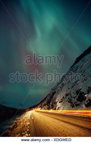 Streaked Truck Lights on Glenn Hwy w/N.Lights AK SC Winter - Stock Photo