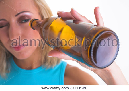 Woman with empty bottle - Stock Photo