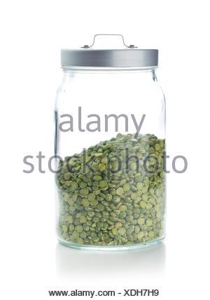 Green split peas in jar. - Stock Photo