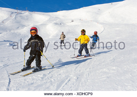 Childrens skiing lesson, Passo de Gardena, Selva Gardena, Italy - Stock Photo