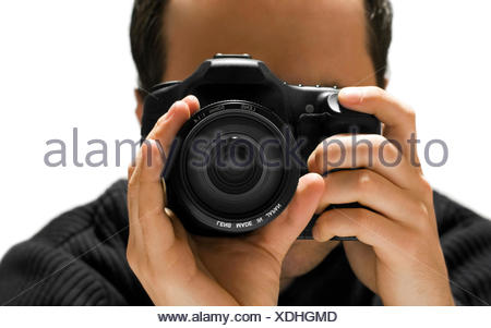 male masculine portrait photo camera lens photographer head front hand hands - Stock Photo