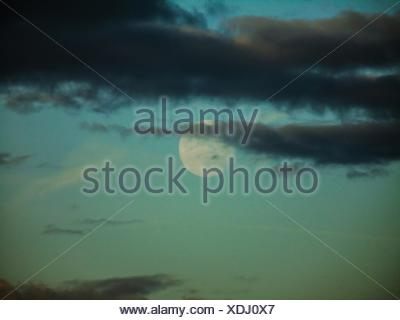 Moon Behind Clouds - Stock Photo