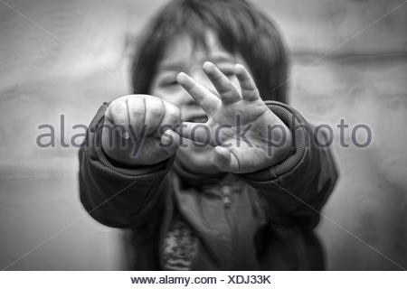 High Angle View Of Baby Holding Finger Outdoors - Stock Photo