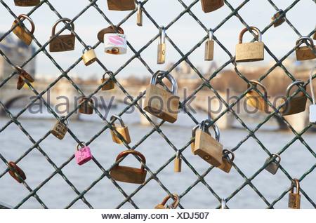 Padlocks on chain link fence - Stock Photo