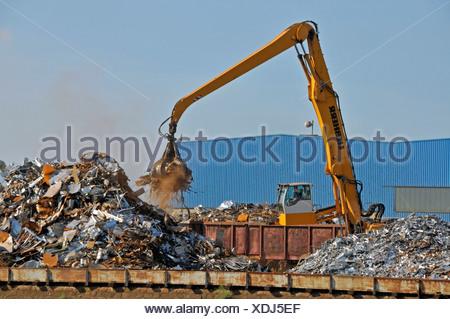 Bulk-handling crane on a scrap yard, scrap island, DuisPort inland port, Duisburg, North Rhine-Westphalia, Germany, Europe - Stock Photo