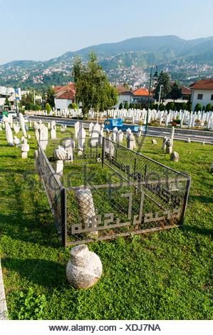 Tomb of 1st president of B&H Alija Izetbegovic, Kovaci war cemetery, Sarajevo, capital of Bosnia and Herzegovina, Europe - Stock Photo