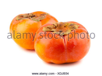 Two persimmon fruits on white background - Stock Photo