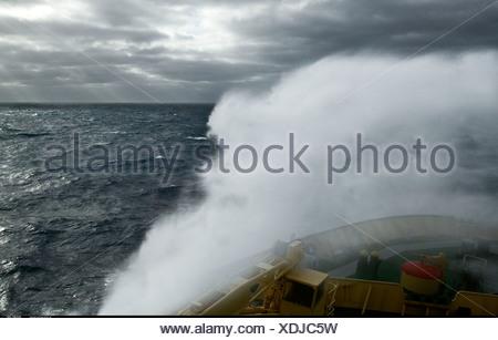 Ice breaker crashing through stormy seas Antartica - Stock Photo